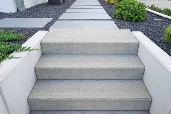 Modern Grey Concrete Steps Leading to Concrete Slab Walkway